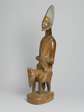 Shango, the Orisha (god) of fire, lightning, and thunder, in the Yoruba religion, depicted on horseback Brooklyn Museum 1992.133.4 Figure of Shango on Horseback.jpg