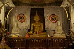 Buddha Statue, Temple of the Tooth Relic, Kandy, Sri Lanka.jpg