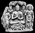 Buddhist Triad Peshawar Museum.jpg