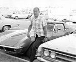 Buzz Aldrin arrives for work, holding the keys to his Corvette.jpg
