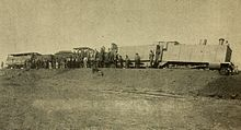Photo of an armoured CGR 3rd Class 4-4-0 1889 locomotive derailed on 12 October 1899 during the first engagement of the Second Boer War at Kraaipan