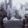 COLLECTIE TROPENMUSEUM De baboe en een andere bediende van het gezin F.W.M. Kerchman bij de baby in de kinderwagen TMnr 60053691.jpg