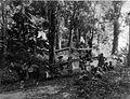 COLLECTIE TROPENMUSEUM Twee dames in draagstoelen worden door het oerwoud geragen begeleid door een man op paard TMnr 60012390.jpg