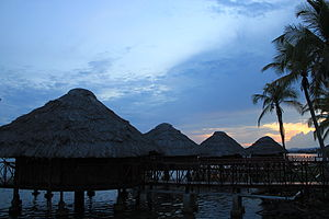 Guna people - Contemporary traditional Guna houses in the Guna Yala built on stilts over shallow coastal marshes