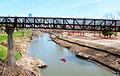 Canoe, Rosemont Pedestrian Bridge & Remains of Supports for former GH&SA Railroad Bridge over Buffalo Bayou near Studemont, Houston, Texas 1402151281 (12567944395).jpg