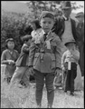 Centerville, California. This youngster is awaiting evacuation bus. Evacuees of Japanese ancestry . . . - NARA - 537552.tif