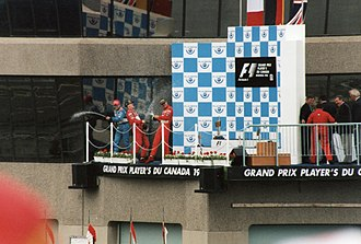 1998 Canadian Grand Prix - Fisichella, Schumacher, and Irvine on the podium after the race.