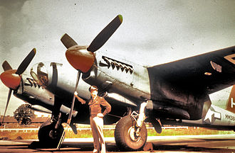 Chalgrove Airfield - An airman of the 25th Bomb Group with a Mosquito (H, serial number MM 388).