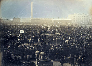 "1840s - April 10: ""Monster Rally"" of Chartists held on Kennington Common in London; the first photograph of a crowd depicts it."
