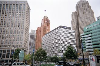 Detroit Financial District - View from Campus Martius Park up Woodward Ave., left to right: The First National Building, One Woodward Avenue, the Guardian, The Qube, Greater Penobscot Building, and One Kennedy Square across from the District.