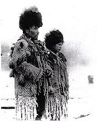 Black and white photograph of Skwxwu7mesh Chief George from the village of Senakw with his daughter in traditional regalia.