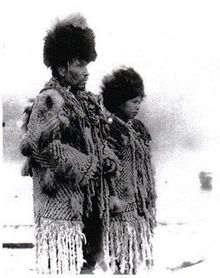 """Black an white photograph of Skwxwu7mesh Chief George from the village of Senakw with his daughter in traditional regalia."""
