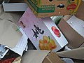 Chinese peach box in the box heap on the market place.jpg