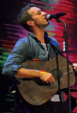 Chris Martin - Martin performing with Coldplay in 2011