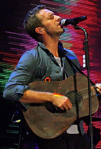 Chris Martin, lead singer of Coldplay Chris Martin + Guitar, 2011 (1, cropped).jpg