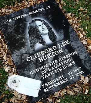 Cliff Burton - Memorial stone near the crash site, next to a CD copy of Master of Puppets.