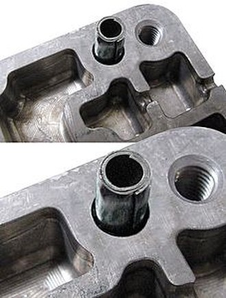 Spring pin - Image: Coiled spring pins solve automotive valve body assembly problem P341708
