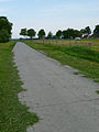 Concrete path through the meadows near Hooghalen.jpg