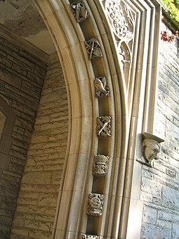 McMaster's oldest buildings are examples of Collegiate Gothic architecture, with architectural elements such as carved ornamentation, bas-reliefs, recessed arched entryways, and ashlar found throughout these buildings. Conhall.jpg