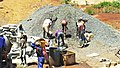 Construction site workers loading water, sand, ballast and cememt into a concrete mixer in Embu, Kenya 5a.jpg