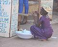 Crouching young woman Gambia.jpg