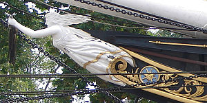 Cutty Sark - The ship's figurehead shows Cutty-sark, the nickname of the witch Nannie Dee who chases Tam o' Shanter, snatching his horse's tail before he escapes by crossing water