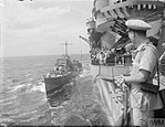DESTROYER OILING FROM HMS ILLUSTRIOUS AT SEA. 18 OCTOBER 1942, ON BOARD THE CARRIER HMS ILLUSTRIOUS IN THE MOZAMBIQUE CHANNEL. A13481.jpg