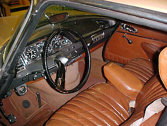 Car controls - 1969 Citroen DS Pallas interior with hydraulic gear selector mounted top right of steering column with a single spoke steering wheel. Note the so-called mushroom brake pedal. (The pedal on the left is the parking brake).