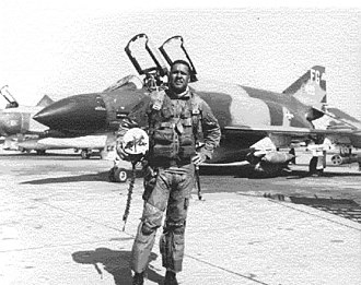 "Ubon Royal Thai Air Force Base - Colonel Daniel ""Chappie"" James, Jr. in front of his McDonnell-Douglas F-4C Phantom (433d TFS) at Ubon. He flew 78 combat missions into North Vietnam, many in the Hanoi/Haiphong area, and led a flight into the ""Bolo"" MiG sweep in which seven Vietnamese People's Air Force MiG-21s were destroyed, the highest total kill of any mission during the Vietnam War."