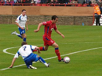 2012–13 FA Cup - Danny Hylton (in red), playing for Aldershot Town, was the competition's top scorer with 8 goals.