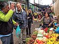 Day trip from Puerto Varas to Isla Grande de Chiloe - a market tour in Ancud, Chile, with our local guide - Bert & Therese listen as the guide waits for his change - (24558278093).jpg