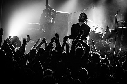 Deafheaven have brought the genre widespread critical acclaim in their fusion of black metal and shoegazing. Deafheaven @ A Colossal Weekend 2017 46.jpg