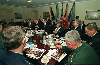 Sandy Berger - Secretary of Defense William S. Cohen (center and pointing hand) gives the opening remarks at a Pentagon briefing for President Bill Clinton and Vice President Al Gore on February 17, 1998. Clinton was in the Pentagon to meet with the Joint Chiefs of Staff and his national security team for a Gulf region update. Berger is seated to Cohen's left.