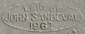 Types of concrete - Concrete in sidewalk stamped with contractor name and date it was laid