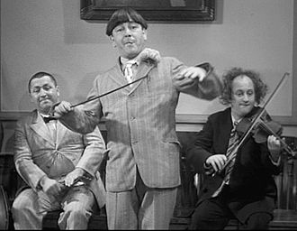 Moe Howard - The Three Stooges: Curly Howard, Moe Howard (center), and Larry Fine in 1936