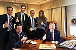 Donald Trump and staff on Air Force One.jpg
