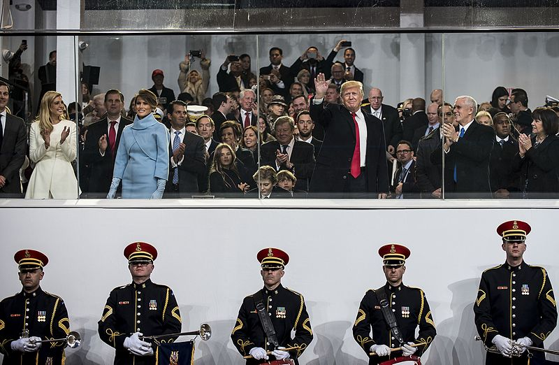 U.S. President Donald Trump greets the crowd from the presidential review stand during the 58th Presidential Inauguration Parade in Washington, D.C., on Jan. 20. The parade route stretched approximately 1.5 miles along Pennsylvania Avenue from the U.S. Capitol to the White House. (U.S. Army Reserve photo by Master Sgt. Michel Sauret)