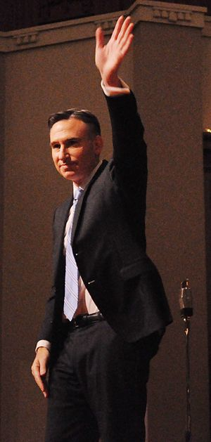 Dow Constantine - Constantine acknowledges crowd applause after taking the oath of office as King County Executive.