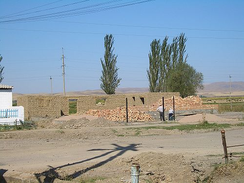A house under construction in Milyanfan village, apparently with both adobe bricks and regular bricks being used.