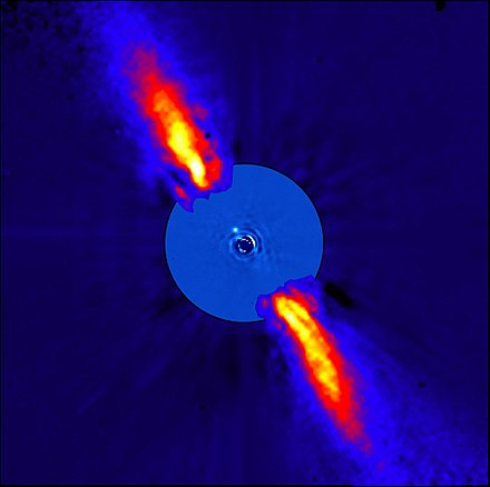 Beta Pictoris with its planet Beta Pictoris b, the light-blue dot off-center, as seen in infrared. It combines two images, the inner disc is at 3.6 um. ESO - Beta Pictoris planet finally imaged (by).jpg