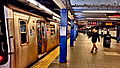 E train at Chambers St-WTC station idling.jpg