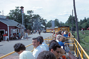 Edaville Railroad - Edaville Railroad train, circa 1966, filled with visitors by the depot building in South Carver, Massachusetts, USA