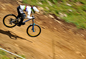 Line of greatest slope - A mountain biker riding a trail which follows the line of greatest slope, or fall line.
