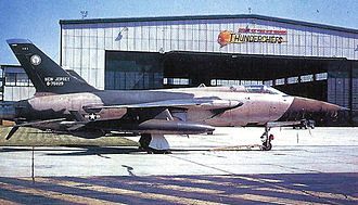 "108th Wing - Republic F-105B AF Serial No. 57-5829. The sign on the hangar proudly proclaiming McGuire AFB as the ""Home of the Air Guard Thunderchiefs""."