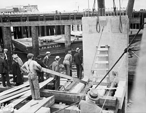 Alaskan Way Seawall - First slab of Seattle Central Waterfront seawall being placed, 1934