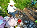 Fish traps in Haikou -.man making traps 02.jpg