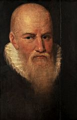 Portrait of a bald man with a beard.