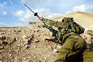 SIMON breach grenade - IDF soldier with a SIMON rifle grenade