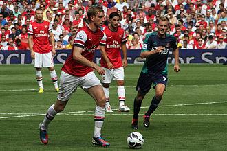 Per Mertesacker - Mertesacker on the ball for Arsenal against Sunderland in 2012