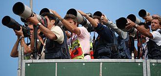 Long-focus lens - Sports photographers using long-focus lenses